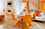Color Psichology In Interior Design : Surprising Orange Color Living Room With White Leather Sofa Cushions Pendant Lamp Orange Futuristic Dining Chairs Big Mirror Inspiring Fireplace Stairwell Parquet Floor