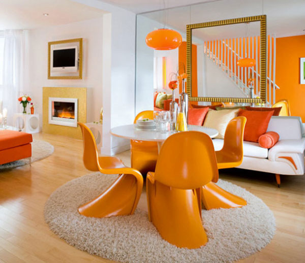 Color Psichology In Interior Design: Surprising Orange Color Living Room With White Leather Sofa Cushions Pendant Lamp Orange Futuristic Dining Chairs Big Mirror Inspiring Fireplace Stairwell Parquet Floor