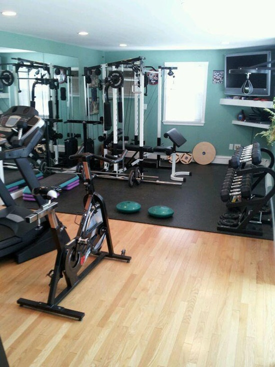 Inspiring Strategically Placed Gym In A Stylist Living Room: Terrific Decoration For Your Home Gym Design Ideas Compact And Versatile Fitness Equipments Multi Functional Home Gym System Big Mirror