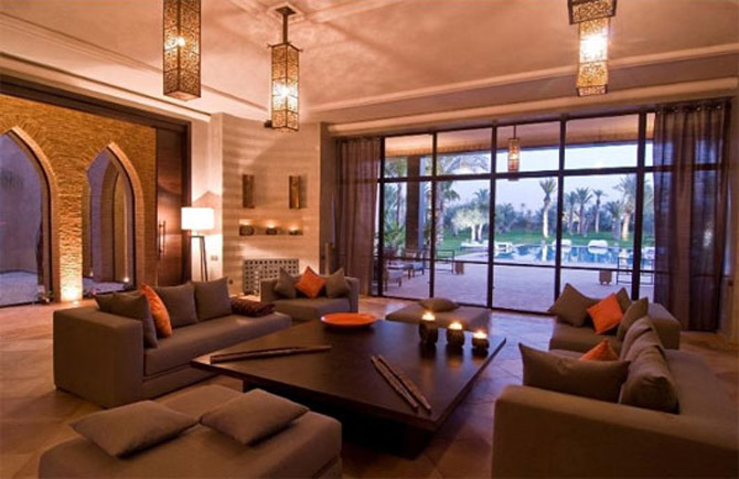 Remarkable Morrocan Style For Your Romantic House : Terrific Garden View Moroccan Decor Ideas With Simple Chandeliers Grey Sofas Orange Cushions Stone Wall Wooden Table Black Candle Holders