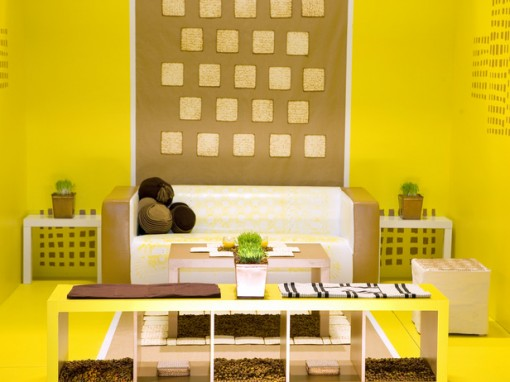 Cool Bright And Colorful Living Room: Theme With Bright Yellow Living Room Wall Design Color Box With A Box Of Chocolate And Yellow Mixed With A Table And Chairs Et Guests With A Small Bookcase Decoration