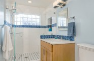 Inspiring Blue and White Bathroom Accessories : Traditional Blue And White Bathroom With Fixed Glass Block Window Glass Shower Enclosure Shower Shelf Niche And Recycled Glass Mosaic Tiles