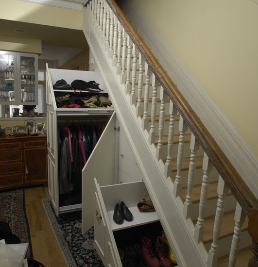 Awesome Understairs Shoe Storage Designs: Traditional Closet With The Storage Compartments Under Stairs Large Coat Rack Middle Section With 3 Drawers And Small Shoe Drawer Eft Side Of The Built In Is Capped With A Bookcase