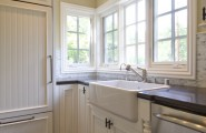 Exciting Farm Sink With Delta Bridge Faucet : Traditional Kitchen Farm House Sink With Traditional Cabinets Calcutta Backsplash Cambria Engineered Stone Countertops And Handscraped Walnut Hardwood Floors