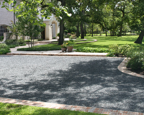 Crushed Gravel Driveway: Traditional Landscape With Granite Gravel Topping That Is Dressed Above Compacted Concrete Sub Base Material
