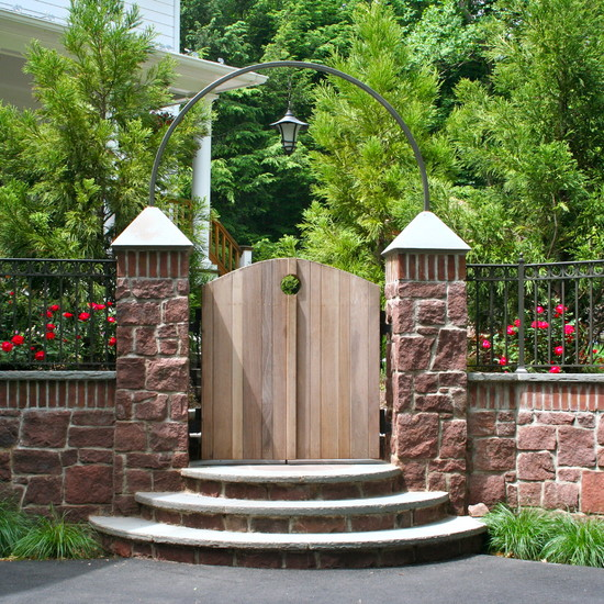 Excellent Solid Outdoor Wood Gates Designs : Traditional Landscape With The Stairs On The Outside Of The Outdoor Wood Gate And Stone Fence