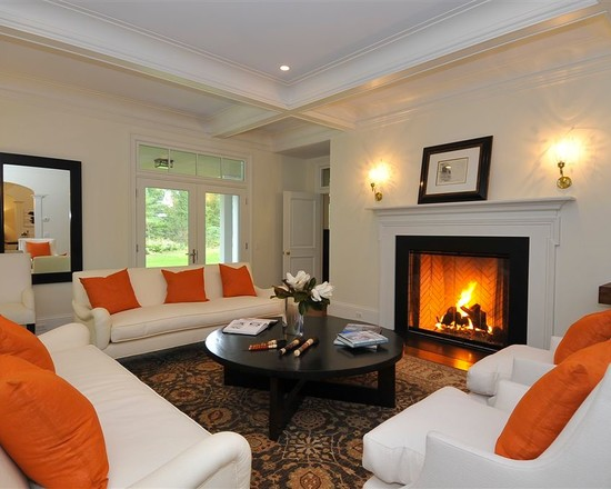 All Kinds of Prefab Fireplace Design Ideas : Traditional Living Room With Convertible A Prefab Fireplace Burns Either Wood Or Gas White Sofa Orange Cushion