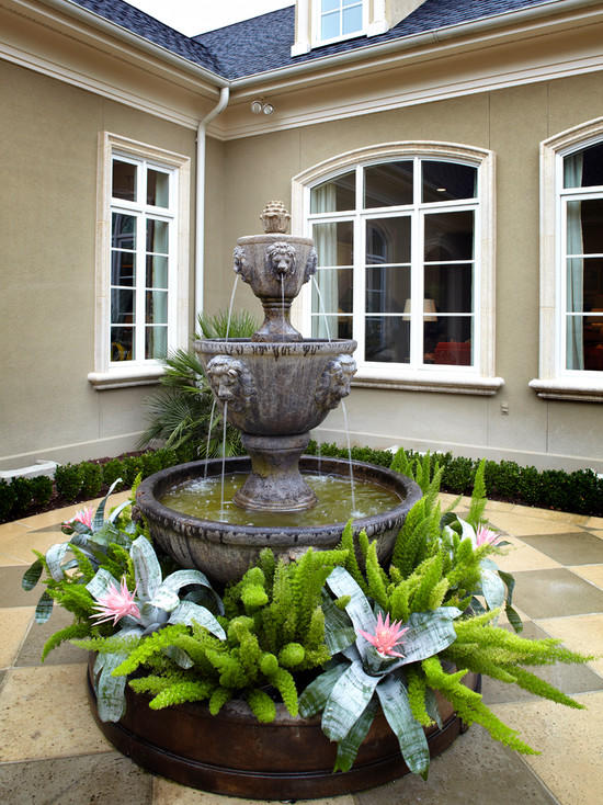 Beautiful Water Fountain Designs With Lights : Traditional Patio Splashing Fountain At Stone Basin Surrounded By Plants