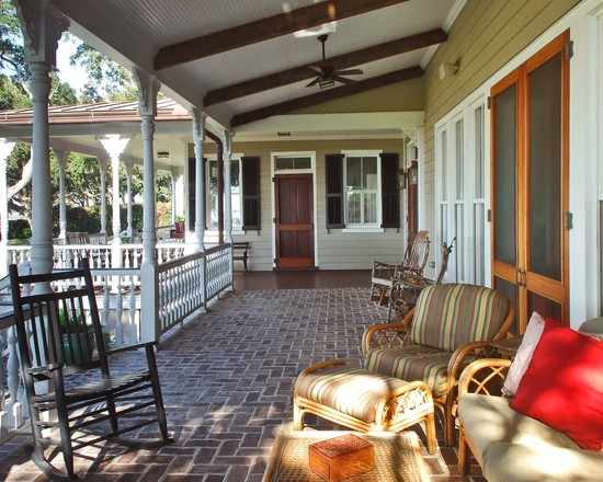 Rustic Cobblestone Tile Flooring: Traditional Porch Cobblestone Floors Metal Roof