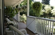 Exciting Custom Porch Railings Designs : Traditional White Porch With Custom Design Porch Railing And Hanging Plants Plus White Rattan Chairs