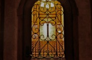 Awesome Wine Cellar Spiral Staircase : Traditional Wine Cellar Bass Of A Spiral Staircase Is This Elegant Arched Door With Detailed Rot Iron And Glass That Welcomes You Into The Beautifully Built And Lit Wine Cellar