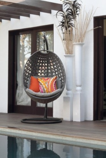Unbelievably Relaxing Piece Of Furniture Hanging Chair: Trendy Outdoor Hanging Chair Egg Shaped With Grey Color And Bright Orange Throw Pillows Located On A Pool Deck