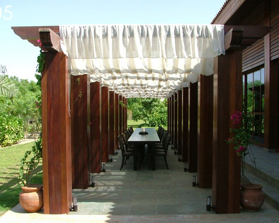 Terrific Pergola Roof Covering Designs: Tropical Patio Pergola Laminated Wood Surround Covered In Fabric Lights At The Bases
