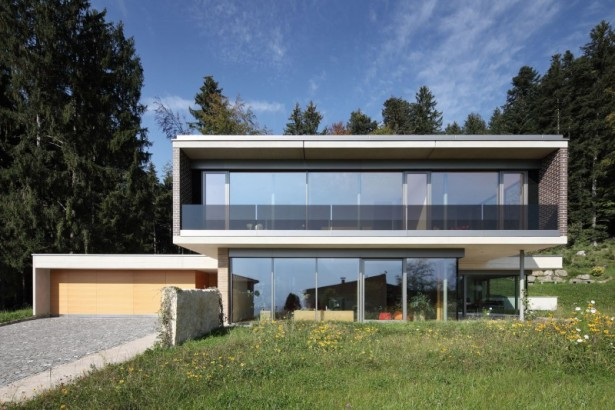 Stylish Modern House Architecture with Two Levels: Two Stories Beautiful Minimalis Home With Glass Facade Surrounding Pinus Tree Green Lawn Brick Wall Aluminum Sills  ~ stevenwardhair.com Architecture Inspiration