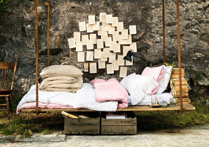 Calm Relaxing Outdoor Hanging Beds For You : Unique Relaxing Outdoor Hanging Bed With Thick Blankets And Soft Pillows Notes Adorning Natural Stone Wall As A Cool Background