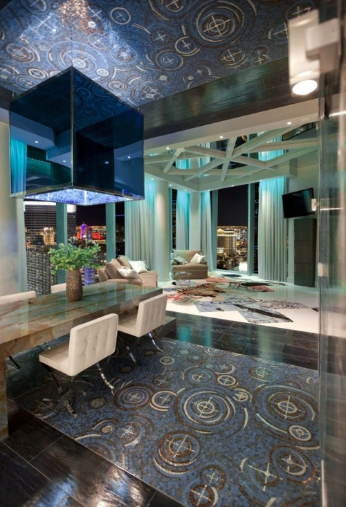 Extremely Modern Funky Apartment Interior Design Ideas : Vegas Style Dining Room Luxurious Thick Marble Table With Modern Feel Shiny Dark Wood Flooring And Mirror Ceiling Reflecting The Funky Swirly Pattern Blue Carpet