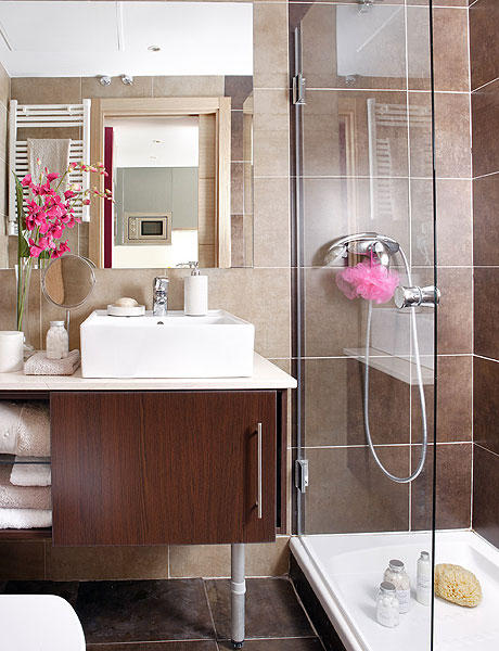 How To Design 40 Square Meter Apartment Comfy: Versatile Small Bathroom With Tiny Shower With Brown Marble Walls Floor And Beside The Sink Clear Glass Partition Shower Mirror Medicine Cabinet Pink Flower Decoration