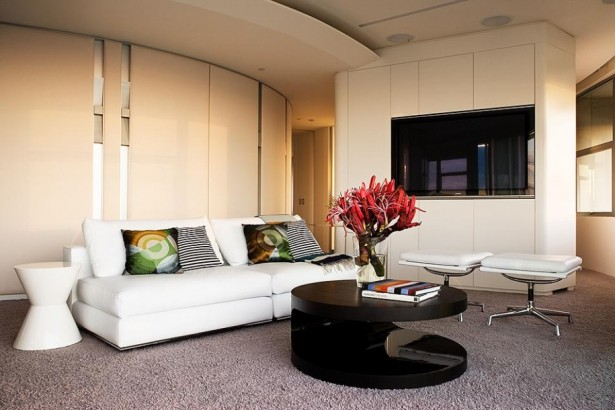 Minimalist Apartment Interior Designs in Modern Way: White Couches Round Coffee Table LED Television Red Flower Grey Carpet ~ stevenwardhair.com Apartments Inspiration