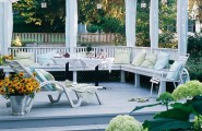 Astonishing Outdoor Deck Design Ideas With Unique Style : White Outdoor Deck Design With Nice Pergola And With White Railings To Blend Into The Landscape With Lazy Chair And Beautiful Garden