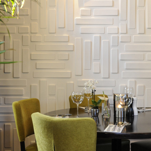 Various Textured Wall At Home Design: White Rectangular Textures For Walls At Contemporary Family Room Round Black Coffe Table Plus Chairs