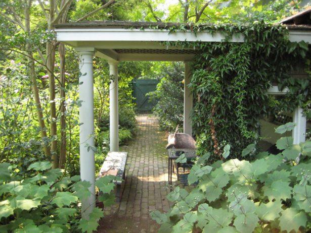 Various Beautiful Peaceful Pergola Design Ideas: Beautiful Covered In Climbing Or Trailing Plants Traditional Garden Pergola Design With Cobblestone Pathways And Surrounding Tree ~ stevenwardhair.com Furniture Inspiration
