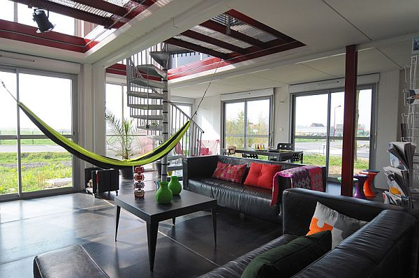 Lovely Houses Made From Shipping Containers With Bold Display: A Lovely Hammock In The Living Area Provides For A Comfy Seating Option