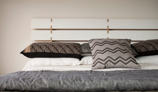 Make Elegant Your Room With These Modern Headboards: A Modern Plywood Headboard