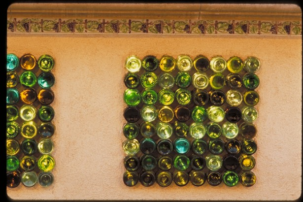 Sparkling Wine Bottle In Eco Friendly Theme For Recycling: Amazing Wall Ornaments Made From The Wine Bottle On The Brown Wall Under The Artistic Pattern ~ stevenwardhair.com Furniture Inspiration
