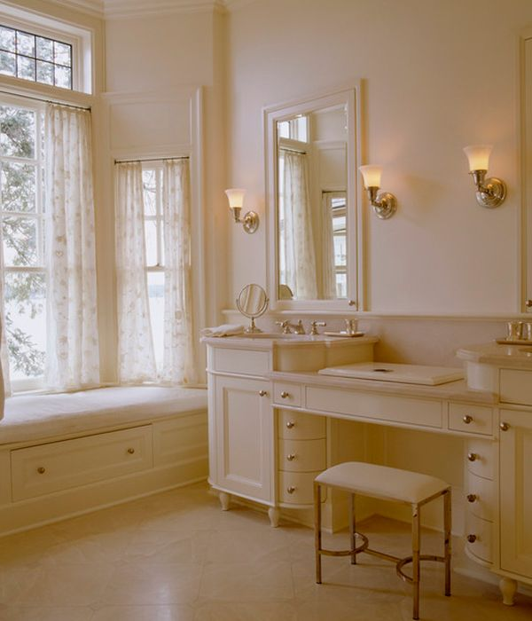 Bathroom Vanity; Personal Taste In Your Bath Room: Ambient Lighting And Warm Hues Enhance The Richness Of This Cream Colored Bathroom Vanity