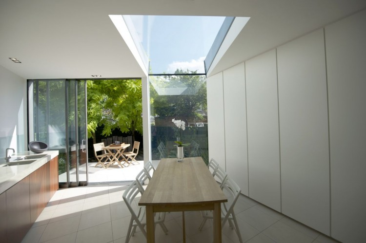 Modern Extension Room Between Old Residences: Amushing Design In Dinning Table In Faceted House