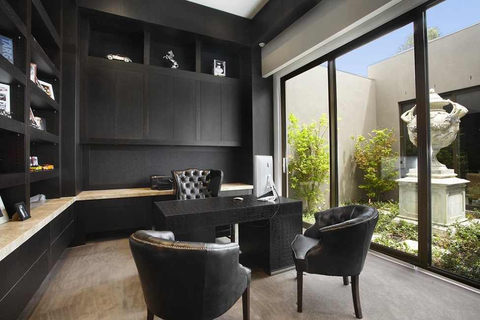 Elegant Modern Residence Design Showcasing Luxury Living: Amusing Working Space In Borrell Street Residence With Black Cabinets Black Desk And Black Chairs