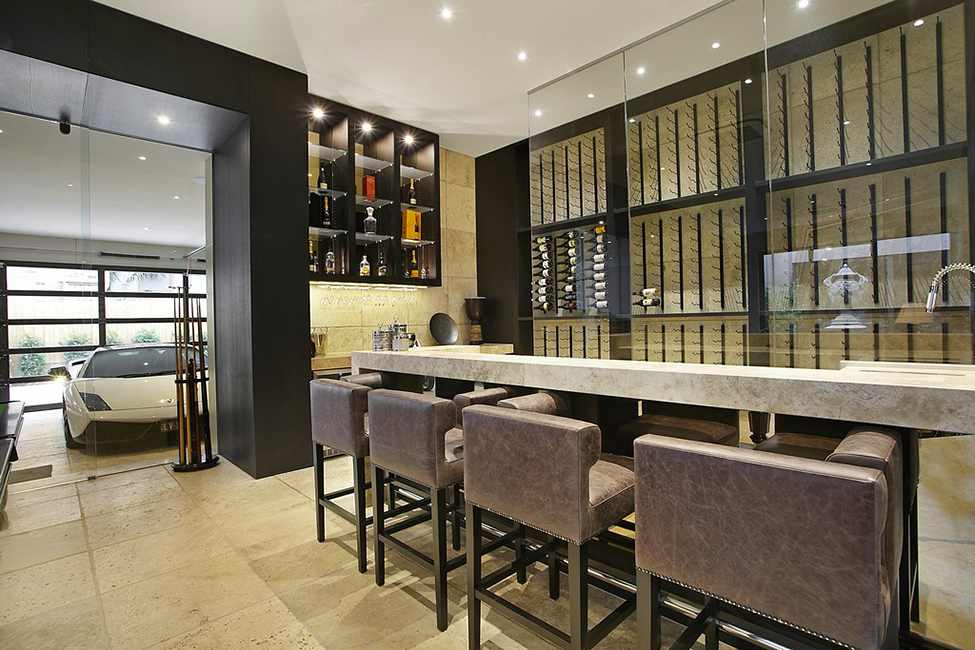 Elegant Modern Residence Design Showcasing Luxury Living: Attractive Brown Counter With Brown Stools And A Wine Storage Near The Borrell Street Residence Garage Space