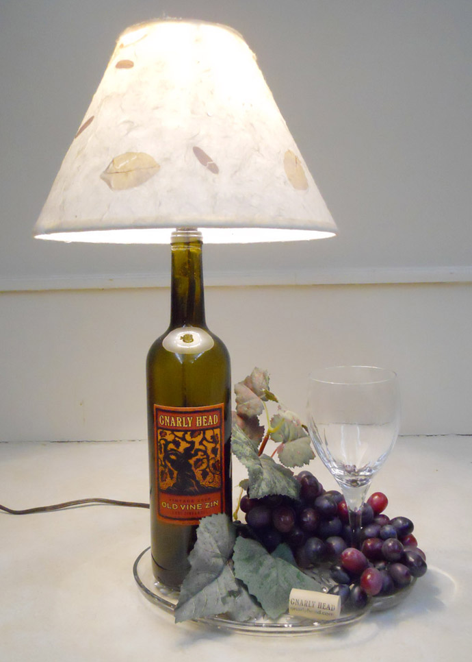 Sparkling Wine Bottle In Eco Friendly Theme For Recycling: Attractive Wine Bottle Lamp For The White Table With Grapes And Delicious Wine Near White Wall