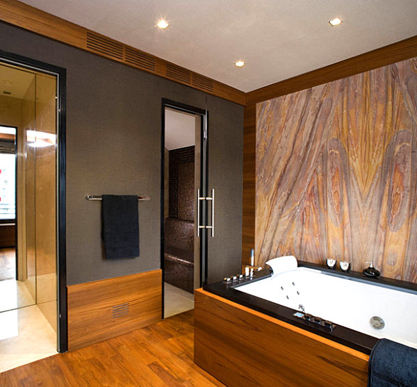 Breathtaking Natural Interior: Mineral Stone Material For Interiors: Bathroom With Sandstone Wall Geometrical Bath Tub Design And Mirrored Storage Door