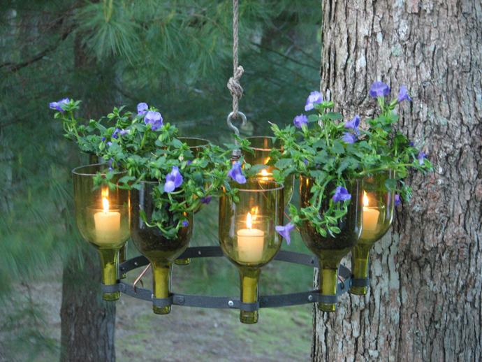 Sparkling Wine Bottle In Eco Friendly Theme For Recycling: Beautiful Outdoor Chandelier Made Of Wine Bottle With Small Candles And Purple Flowers Hanging On The Tree