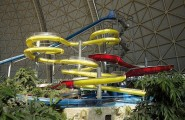 The Fascinating And Largest Indoor Vacation In Dome : Blue Red And Yellow Spiral Water Slides In Water Park
