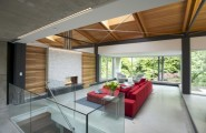 Modern Natural House With The Natural Color : Bright Accents Of Red Energize The Room With Wooden Ceiling Design
