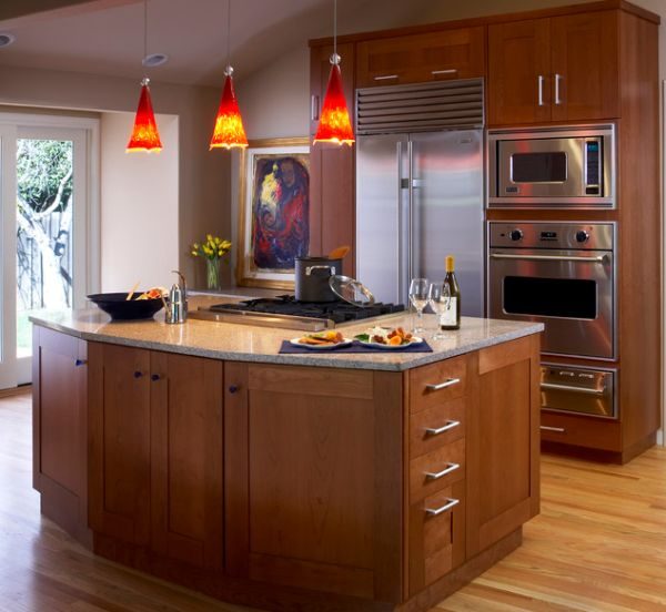 Doing Up Your Kitchen With Astounding Hanging Pendant Lights: 55 Inspiring Images: Bright Red Pendant Lights Offer A Vivid Contrast To This Largely Neutral Kitchen