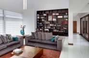 Beautiful And Stylish Contemporary Home Interior Design By Arquitectura En Movimiento : Brown Wooden Shelf Behind Grey Sofa