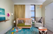 Unique Nursery Theme That You Can Follow : Chic Modern Nursery Design With Wooden Crib On Blue Carpet