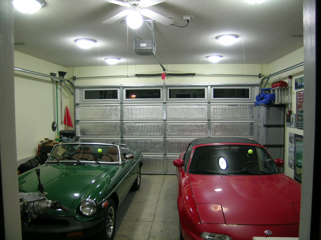 Fantastic Corner Garage Design Furnished With Great Furniture : Classy Cars Shiny Ceiling Light Corner Garage Design