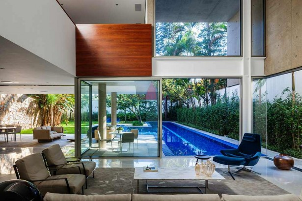 Luxurious Modern Home Design; Four Leveled House: Comfortable Family Room With Brown Sofas And Blue Chair ~ stevenwardhair.com Modern Home Design Inspiration