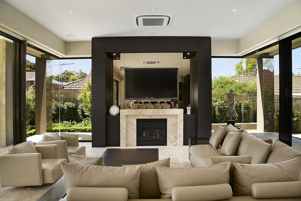 Elegant Modern Residence Design Showcasing Luxury Living: Comfortable Living Room In Borrell Street Residence With Brown Sofa Black Fireplace And Brown Floor