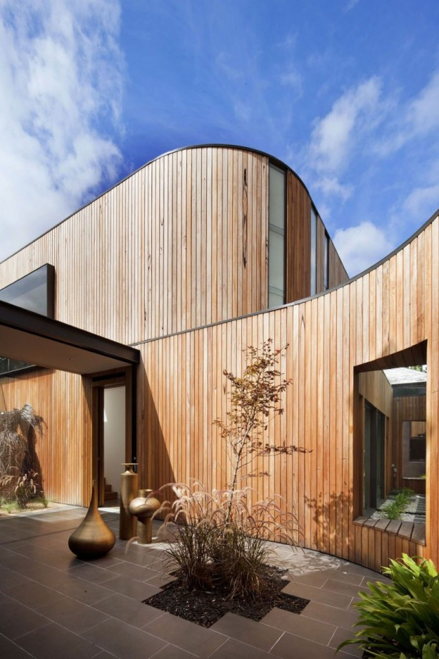 Contemporary Home Completed With Plants And Gold Potteries