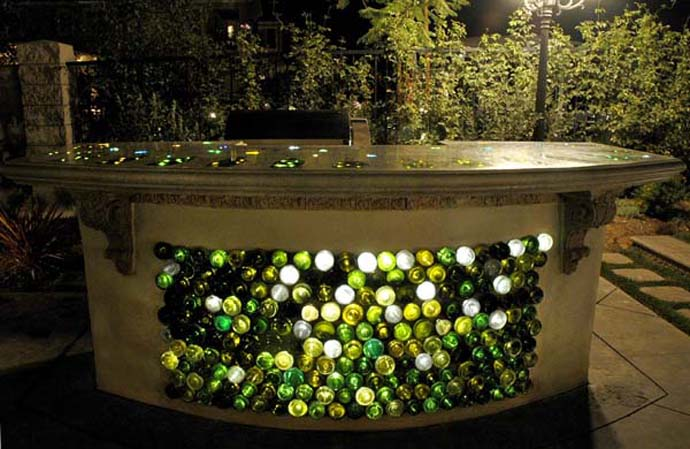 Sparkling Wine Bottle In Eco Friendly Theme For Recycling: Contemporary Outdoor Counter With Interesting Wine Bottle Arrangement And Artistic Pattern On It For The Garden Space