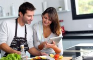 High End Kitchen Gadget For Your Kitchen : Couple In The Kitchen Using Tablet