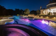 Extravagant Swimming Pool Resembling Violin Shape : Creative Swimming Pool Designs Ideas View By Night With Colorful Lighting