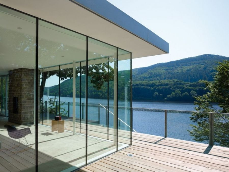Tranquil House With Lake View Near The Lake Rur In Kreuzau : Exciting Clean Glass Wall Separated Thr Deck And Living Space