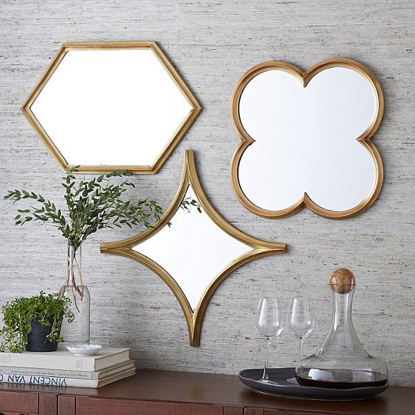 Mesmerizing Wall Decor: Dining Room Attraction: Exquisite Plated Brass Mirrors On Wall Over The Wooden Board With Vase