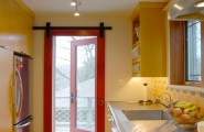 Amazing Entrance Design Ideas For Every Home Design : Fabulous Small Kitchen Design With Red Framed Glass Slide Door